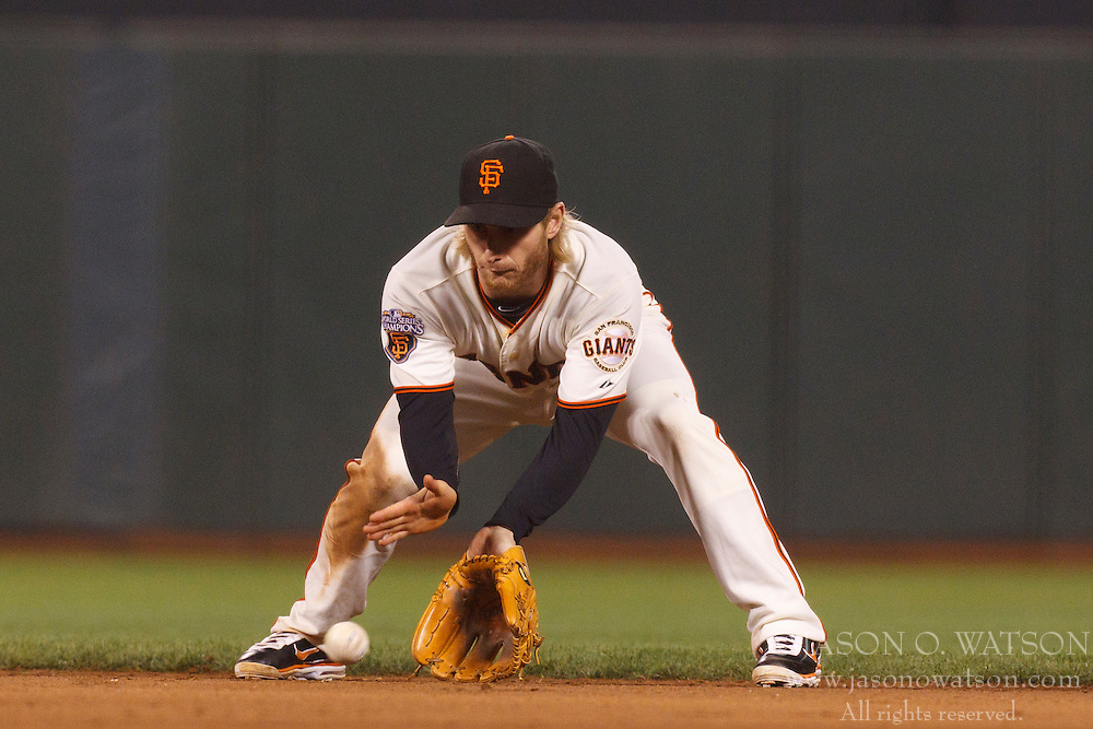 Sep 26, 2011; San Francisco, CA, USA;  San Francisco Giants shortstop Mike Fontenot (14) fields a ground ball against the Colorado Rockies during the sixth inning at AT&T Park.