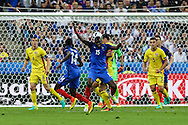 SAINT-DENIS, FRANCE, 10.06.2016 - FRANCE-ROMANIA - Paul Pogba of France dispute the ball with Cristian Sapunaru of Romania, in a match valid for the 1st round of Group A of Euro 2016 in the Stade de France in Saint-Denis , on Friday (10).
