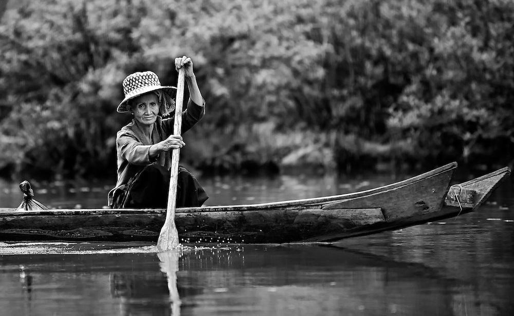 An elderly woman fishing the Nam Tha (river), Luang Namtha, Laos.