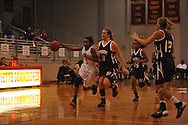 Lafayette High's Shaniyah Buford (3) vs. New Albany's Kayla Parker (15) and New Albany's Terrica Smith (11) in girls high school basketball action in Oxford, Miss., on Friday, January 10, 2014. Lafayette High won 47-38.