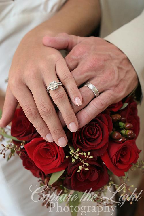 Bride Groom wedding rings and flowers.