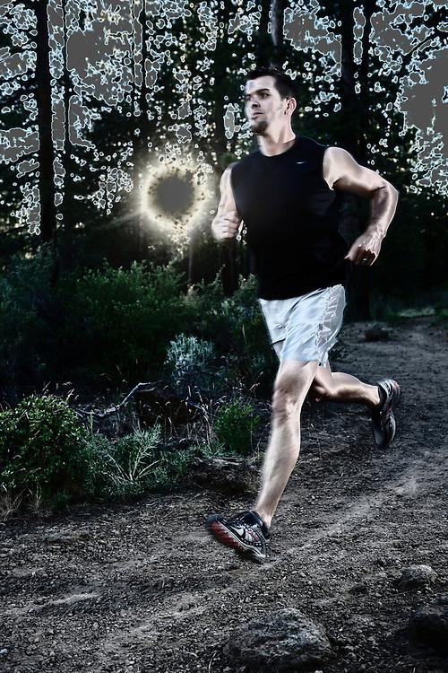 Man running in forest, Deschutes River,Bend,Oregon,USA.model release 0238,