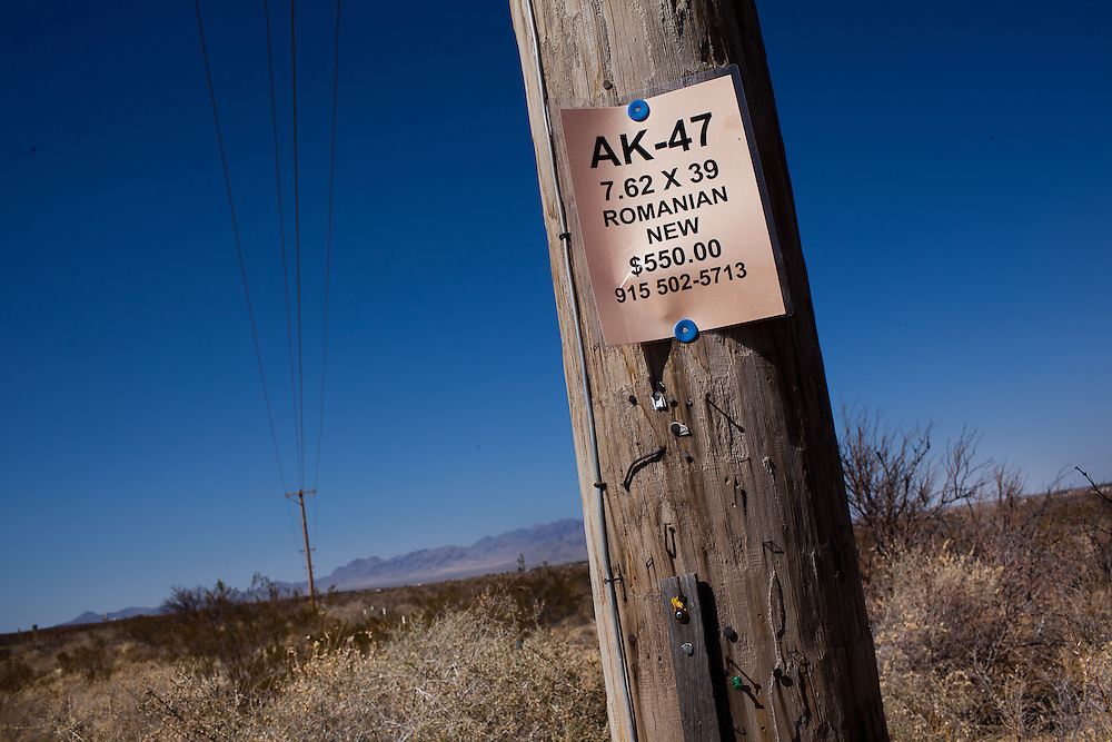 A sign selling AK-47 is seen in Chaparral, New Mexico where allegedly a ring of gun runners was purchasing arms. Recently federal authorities arrested the mayor, police chief, and trustees who were allegedly operating an illegal gun running ring.
