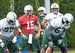 May 24, 2012; Florham Park, NJ, USA; New York Jets quarterback Tim Tebow (15) during the New York Jets OTA at their training facility.