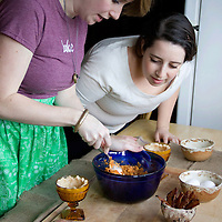 Clare Kolat and Erin Schechtman work together to mix the ingredients for the spicy sweet potato pies.