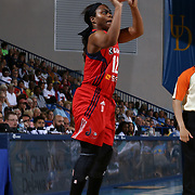 Washington Mystics Guard Ivory Latta (12) attempts the three in the second half of a WNBA preseason basketball game between the Chicago Sky and the Washington Mystics Tuesday, May. 13, 2014 at The Bob Carpenter Sports Convocation Center in Newark, DEL