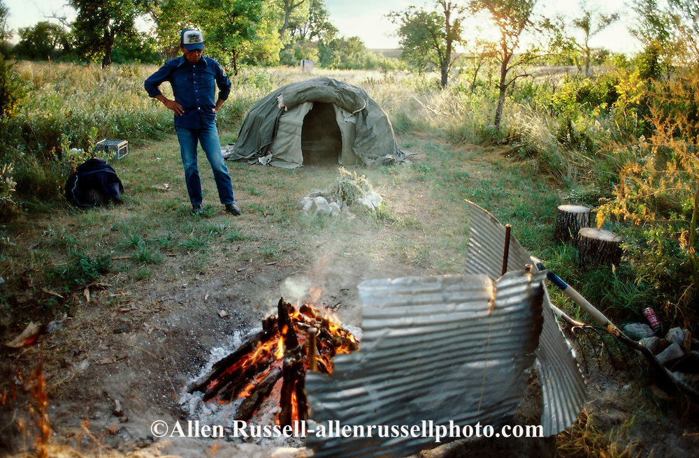 Pine Ridge Sioux Indian Reservation, South Dakota, Oglala Sioux (Lakota) heats rocks while preparing for sweat lodge ceremony