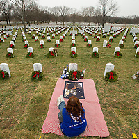 Cathy Powers visits the gravesite of her son Bryce Kenneth Powers, a senior Airman in the Air Force during National Wreaths Across America Day at Arlington National Cemetery in Arlington, V.A. December 14, 2013. Powers died April 29, 2013.  Among the friends and family members, volunteers also placed thousands of remembrance wreaths on headstones around the cemetery during National Wreaths Across America Day.