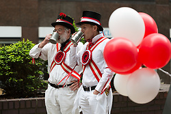© Licensed to London News Pictures. 21/04/2017. LONDON, UK. Morris dancers enjoy a pint in tankards after performing in Leadenhall Market in the City of London today, ahead of the official St George's Day this Sunday. Photo credit: Vickie Flores/LNP