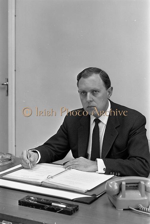 19/09/1963<br /> 09/19/1963<br /> 19 September 1963<br /> Mr. C.D. Cooke, at his desk at I.C.T. Adelaide Road, Dublin.