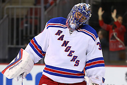 Oct 21, 2014; Newark, NJ, USA; New York Rangers goalie Henrik Lundqvist (30) reacts after giving up a goal to New Jersey Devils center Adam Henrique (14) (not shown) during the second period at Prudential Center.