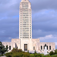 Louisiana State Capitol Building in Baton Rouge, Louisiana<br /> At 34 stories, the limestone Louisiana State Capitol in Baton Rouge is the nation&rsquo;s tallest. It is also a memorial to Huey Long who initiated it and then was shot and buried there three years after its completion in 1932. The statue in the foreground is his grave. The 18th step leading to the front door marks when Louisiana became the 18th state on April 30, 1812. The rest of the 48 granite steps list each state in order of their statehood.
