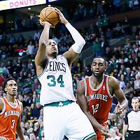 21 December 2012: Boston Celtics small forward Paul Pierce (34) takes a jumpshot over Milwaukee Bucks power forward Luc Richard Mbah a Moute (12) during the Milwaukee Bucks 99-94 overtime victory over the Boston Celtics at the TD Garden, Boston, Massachusetts, USA.