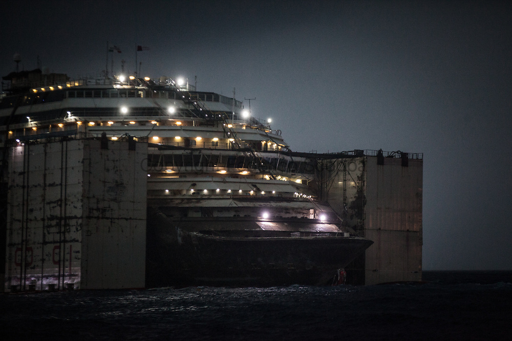 Heavy tunder storm hits the Costa Concordia ship yard one day before the removal operation