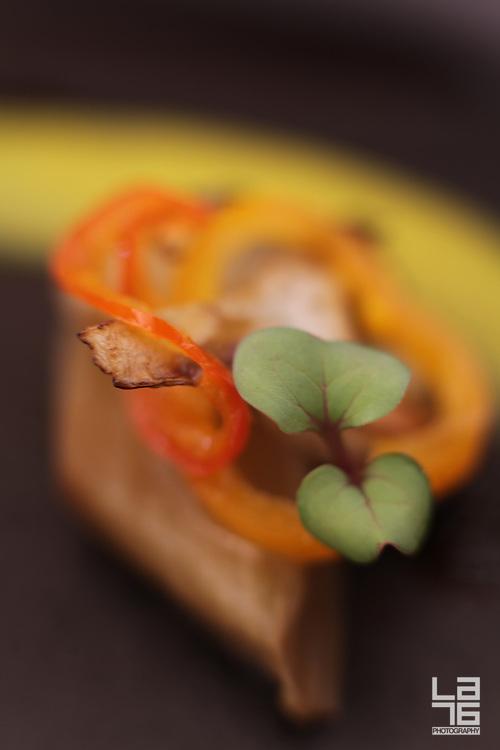 Roasted spring lamb, baby artichokes, potato 'mil hojas', meyer lemon puree, lamb chorizo, jingle bell peppers and lamb jus.