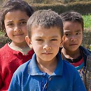 Three children in rural area outside Bhaktapur, Nepal