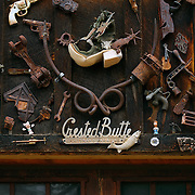 "SHOT 7/08/2007 - A variety of old items, including old tools and toys, adorn the side of a garage in Crested Butte, Colo. Often called ""the last great Colorado ski town"", Crested Butte is a small resort town located in Gunnison County in the U.S. state of Colorado. A former coal mining hub, Crested Butte is now a destination for skiing, mountain biking, and a variety of other outdoor activities. The Colorado state legislature has designated Crested Butte the wildflower capital of Colorado..(Photo by Marc Piscotty / © 2007)"