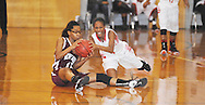 Lafayette High's Memorie McIntosh (4) and. New Albany's Kayla  Parker (15) go for the ball in girls high school basketball action in Oxford, Miss., on Friday, January 10, 2014. Lafayette High won 47-38.