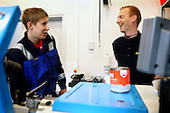 A guard (right) is enjoying time with an inmate during a welding workshop carried out inside the luxurious Halden Fengsel, (prison) near Oslo, Norway.