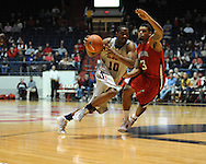 "Mississippi's LaDarius White (10) drives on Louisiana-Lafayette's Darnell Jackson (3) at C.M. ""Tad"" Smith Coliseum in Oxford, Miss. on Wednesday, December 14, 2011. (AP Photo/Oxford Eagle, Bruce Newman)"