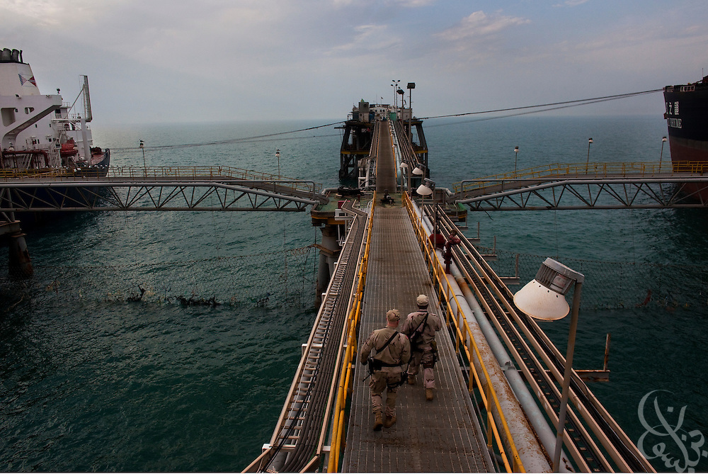 US Navy security personnel move about the Al Basrah oil terminal (ABOT) 50 kilometers off the coast of Iraq in the Northern Arabian Gulf February 2, 2010. Currently the Coalition Task Force Iraq Maritime comprised of US and UK sailors and marines are responsible for the defense of this vital Iraqi infrastructure asset. By 2011 however, all coalition forces are planning to withdrawal from Iraq, so the task force is now training and supporting Iraqi Naval and security forces to eventualluy assume the role of protecting the platform themselves.
