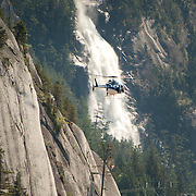 A helicopter flies in front of Shannon Falls.  Saturday, may 27, 2017.  Photo by David Buzzard/For The Squamish Chief.