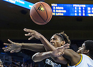 Colorado forward Xavier Johnson, left, and UCLA forward Tony Parker, battle for a loose ball in the first half of their basketball game at UCLA's Pauley Pavilion during an NCAA college basketball game, Thursday, Feb. 13, 2014 in Los Angeles. (AP Photo/Ringo H.W. Chiu)