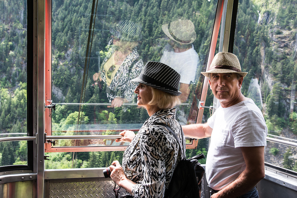 Picture taken on Hell's Gate airtram, going down to Fraser river canyon. Notice the contrast between the wife's elegant attire and the husband's casual appearance.