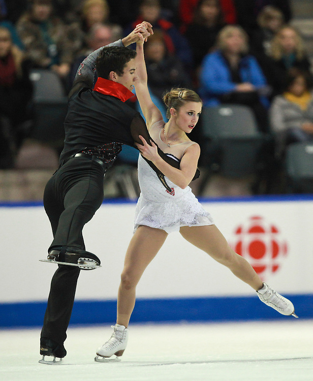 20101030 -- Kingston, Ontario -- Paige Lawrence and Rudi Swiegers of Canada skate their free skate in the pairs competition at Skate Canada International in Kingston, Ontario, Canada, October 30, 2010. <br /> AFP PHOTO/Geoff Robins