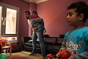CAIRO, EGYPT - FEBRUARY 25: Al Jazeera English (AJE) producer Baher Mohamed plays with his daughter Fairouz (c) and son Hazem (r) February 25, 2015 at their family apartment in the Sheikh Zayed district on the outskirts of Cairo, Egypt. Baher, and fellow Al Jazeera defendent Mohamed Fahmy were conditionally released on Feb 12, 2015 following Egypt's highest appeal courts decision to grant them a retrial, which has since been postponed until March 8. (Photo by Scott Nelson, for the Washington Post)