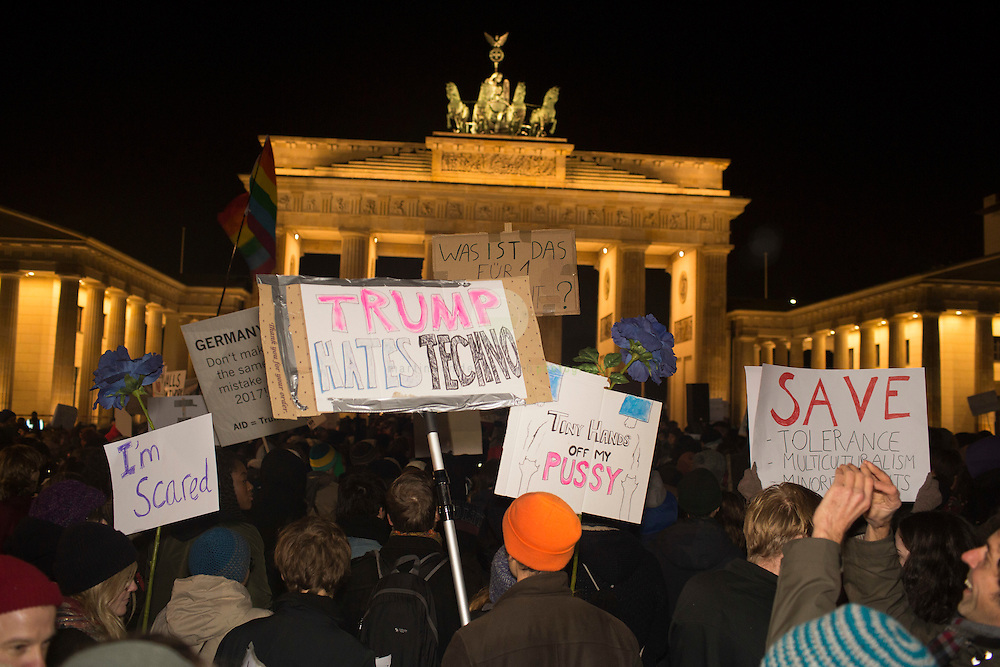 BERLIN, Brandenburg Gate, 12.11.2016 / Hundreds of people, among them many Americans, gathered in the center of the German capital to protest against President-elect Donald Trump.<br /> <br /> About 700 protesters followed a Facebook initiative to rally at the Brandenburg Gate, next to the U.S. Embassy. At this peaceful event, everyone was invited to speak out against Trump and to describe the expectations in the 45th president of the United States. Many spoke about the fear of growing discriminations against minorities.<br /> <br /> The Trump hates Techno sign seems to be a reference to the status of Berlin as the techno capital of the world.