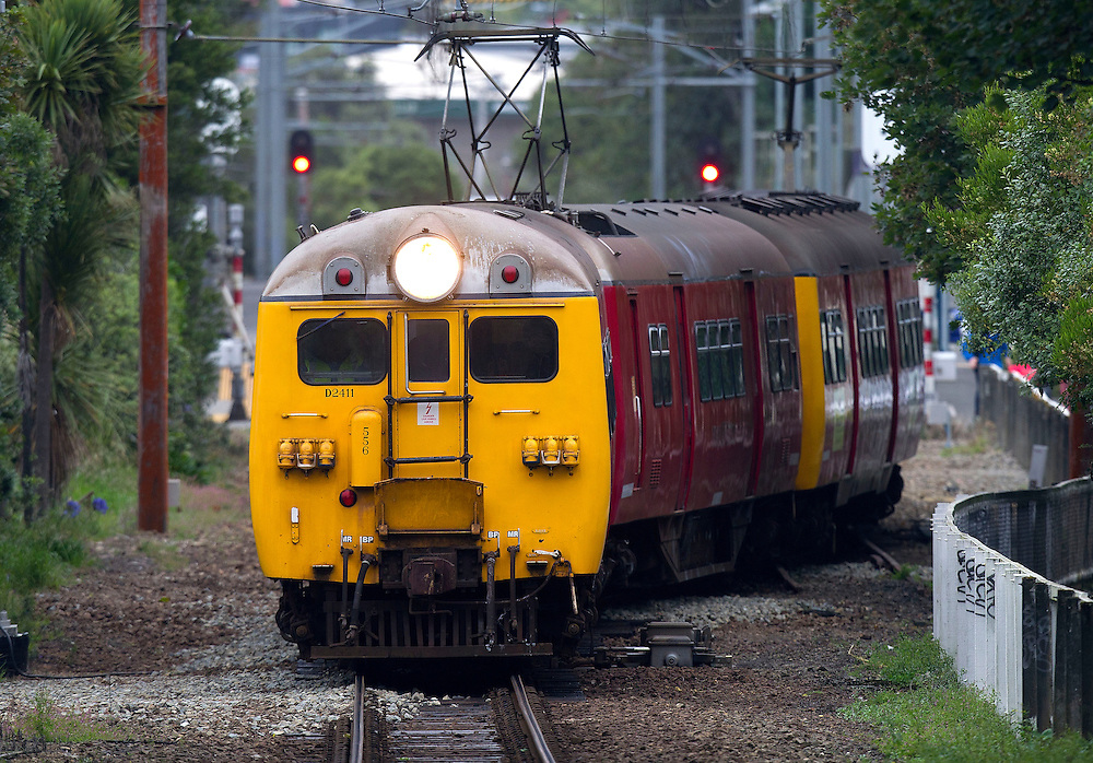 An old English Electric passenger train leaves Khandallah Railway Station for the last time on the Johnsoville railway line, Wellington, New Zealand, Monday, March 19, 2011. The new Martangi electric trains take over the line from today and this was the last trip by the 60 year old passenger trains.Credit: SNPA / Marty Melville.