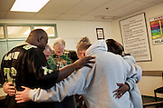 David Wagler (center) and others pray the Serenity Prayer at the end of a group session at Maryhaven, a healthcare facility specializing in treatment for people with alcohol and drug dependencies in Columbus, Ohio on Tuesday, April 21, 2009. Wagler graduated from the program that day after five months of living at the facility.