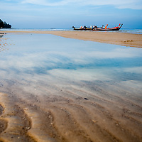 Boats and reflections on a Thai Beach