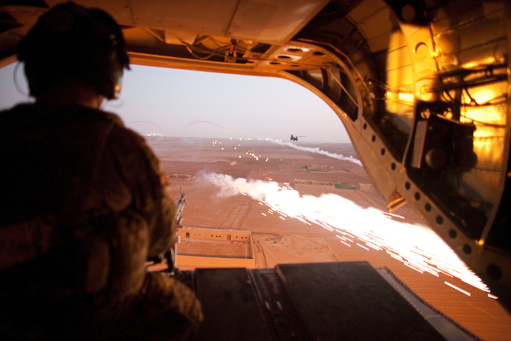 A CH-47 Chinook helicopter deploys chaff to counter any heat seeking ground fire as it prepares to deploy troops as part of Operation Tora Pishaw 5 in Nad e Ali North, Helmand Province, Afghanistan on the 11th of November 2011.