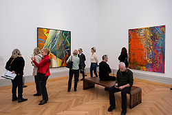 Visitors looking at paintings by Gerhard Richter     at new Museum Barberini in Potsdam Germany