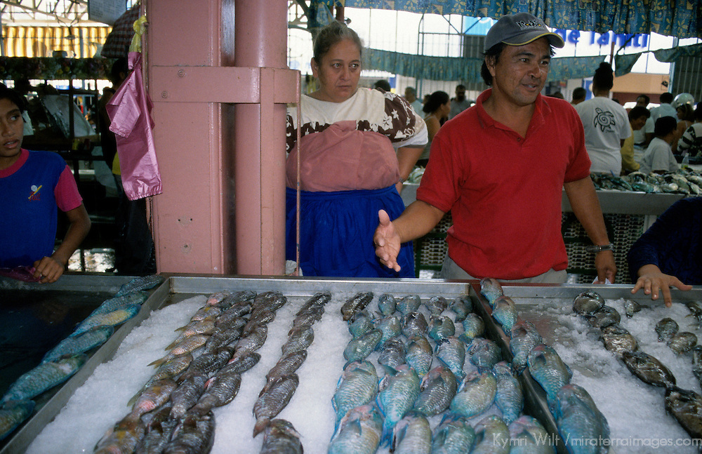 Oceania, French Polynesia, Tahiti. Fish vendor at Papeete Market.