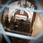 Orthodox Jews pray inside the newly built Synagogue near the settlement Kiryat Arba close to Hebron. Image © Angelos Giotopoulos/Falcon Photo Agency