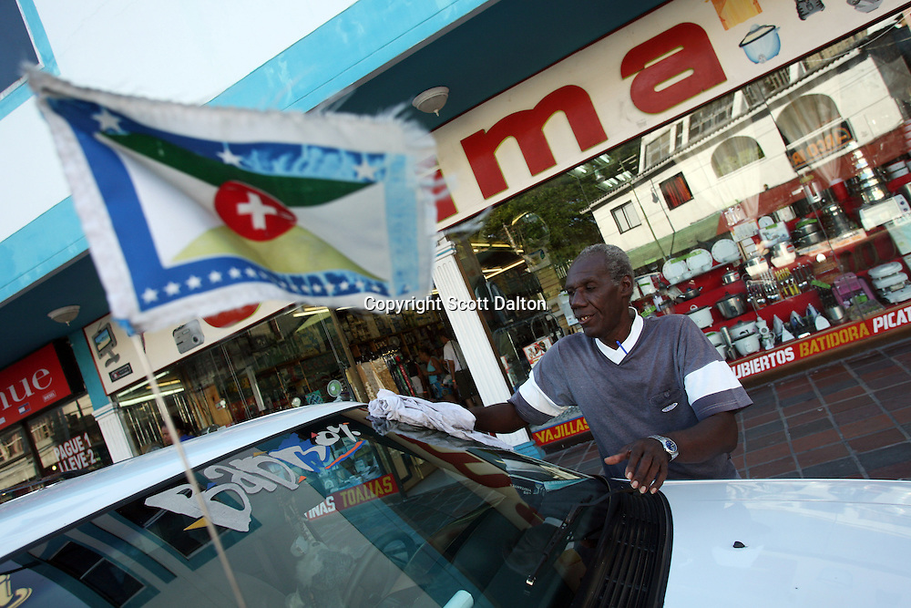 A taxi driver washes his car that displays the flag of the independence movement in San Andres, a small island in the Caribbean, on Tuesday, January 22, 2008. The native population of San Andres, who call themselves Raizal, have created an independence movement after becoming frustrated with Colombian rule. (Photo/Scott Dalton).