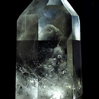 This quartz crystal point has some incredible inclusions. From a custom crystal photography shoot. Property released