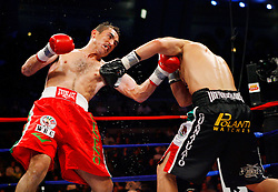 October 18, 2008; Atlantic City, NJ, USA;  Marco A. Rubio (red trunks) and Enrique Ornelas (black trunks) trade punches during their 12 round WBC Middleweight Title Eliminator fight at Boardwalk Hall in Atlantic City, NJ.  Rubio won the fight via 12 round split decision.