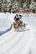 Musher Egil Ellis competing in the Fur Rendezvous World Sled Dog Championships at Campbell Airstrip in Anchorage in Southcentral Alaska. Winter. Afternoon.