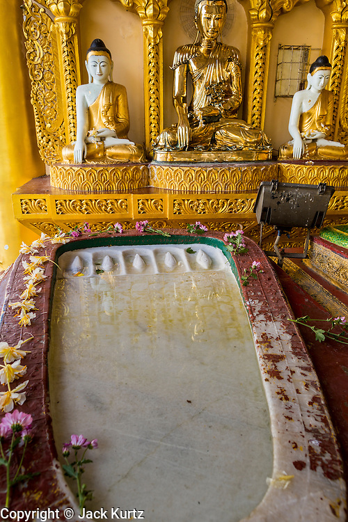 07 JUNE 2014 - YANGON, YANGON REGION, MYANMAR: A footprint of the Buddha at Shwedagon Pagoda in Yangon. Shwedagon Pagoda is officially called Shwedagon Zedi Daw and is also known as the Great Dagon Pagoda and the Golden Pagoda. It's a 99 metres (325ft) gilded pagoda and stupa located in Yangon. It is the most sacred Buddhist pagoda in Myanmar with relics of the past four Buddhas enshrined within: the staff of Kakusandha, the water filter of Koṇāgamana, a piece of the robe of Kassapa and eight strands of hair from Gautama, the historical Buddha.   PHOTO BY JACK KURTZ