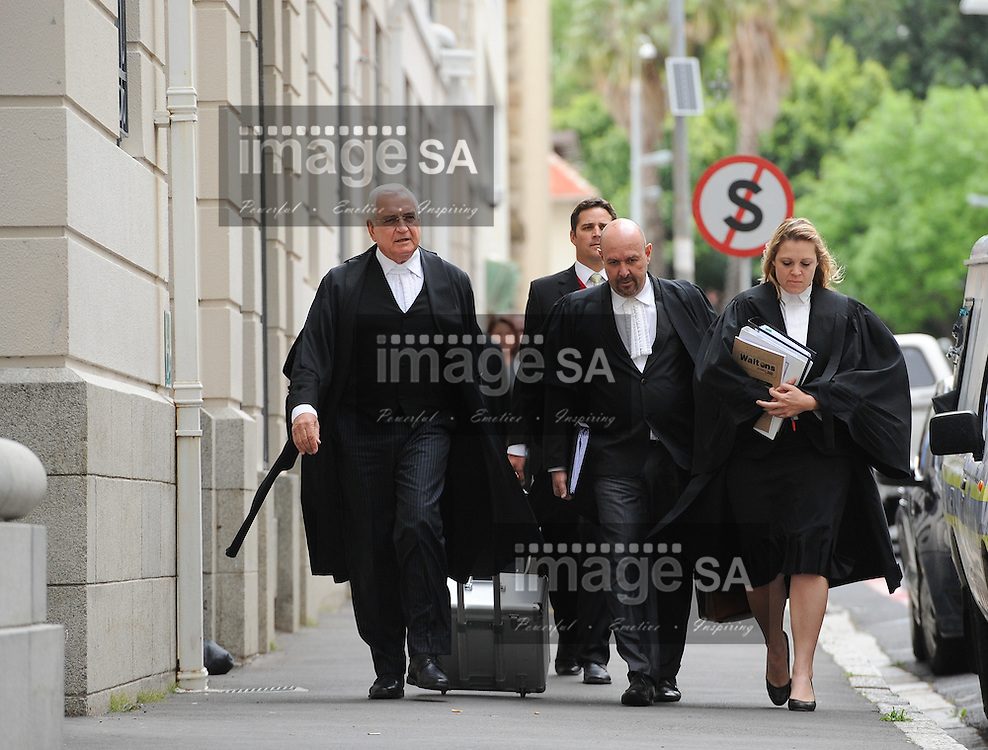 CAPE TOWN, SOUTH AFRICA - Thursday 8 October 2014,   Counsel for the defence, Francois van Zyl SC, walks with his team towards the court entrance during Day 3 of the Shrien Dewani trial at the Cape High Court before Judge Jeanette Traverso. Dewani is caused of hiring hit men to murder his wife, Anni. Anni Ninna Dewani (n&eacute;e Hindocha; 12 March 1982 &ndash; 13 November 2010) was a Swedish woman who, while on her honeymoon in South Africa, was kidnapped and then murdered in Gugulethu township near Cape Town on 13 November 2010 (wikipedia).<br /> Photo by Roger Sedres