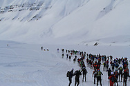 Crowd of skiers head into mountains at start of the northernmost ski marathon in the world outside Longyearbyen on Spitsbergen island in April; Svalbard, Norway.