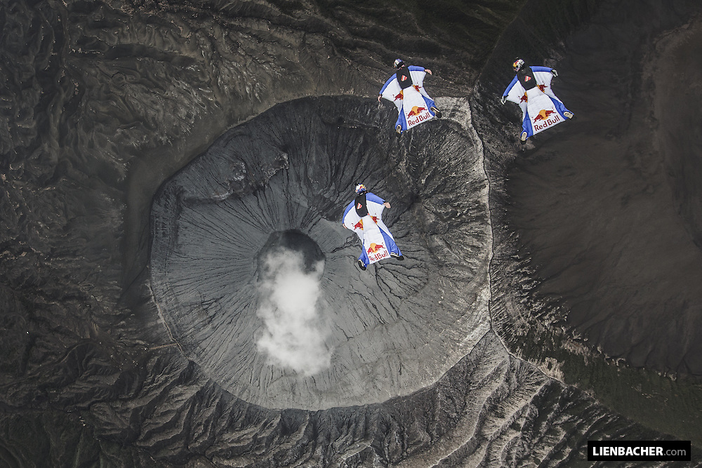 Marco Waltenspiel, Marco Fuerst and Georg Lettner of the Red Bull Skydive Team fly their wingsuits in tight formation above the crater of Mt. Bromo in Indonesia, March 2nd 2015