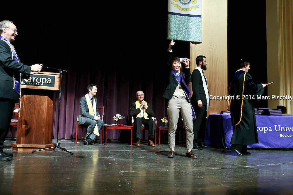 SHOT 5/10/15 3:50:59 PM - Naropa University Spring 2015 Commencement ceremonies at Macky Auditorium in Boulder, Co. Sunday. Parker J. Palmer, a world-renowned author and activist known for his work in education and social change, delivered the commencement speech to more than 300 graduate and undergraduate students along with Naropa faculty and graduate's family members. Naropa University is a private liberal arts college in Boulder, Colorado founded in 1974 by Tibetan Buddhist teacher and Oxford University scholar Chögyam Trungpa. (Photo by Marc Piscotty / © 2014)