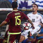 Uruguay Midfielder GASTON RAMIREZ (10), right, passes the ball  as Venezuela Midfielder ALEJANDRO GUERRA (15) defends in the first half of a Copa America Centenario Group C match between Uruguay and Venezuela Thursday, June. 09, 2016 at Lincoln Financial Field in Philadelphia, PA.