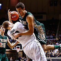 WEST LAFAYETTE, IN - DECEMBER 29: Kyle Gaillard #23 of the William & Mary Tribe falls on Travis Carroll #50 of the Purdue Boilermakers at Mackey Arena on December 29, 2012 in West Lafayette, Indiana. (Photo by Michael Hickey/Getty Images) *** Local Caption *** Kyle Gaillard; Travis Carroll