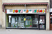 "Tots ""2"" Teens vacated shop window displaying Stroud Rambling Club information, Dursley.Recession 2010: Parsonage Street, Dursley, Gloucestershire shops closed due to economic downturn."